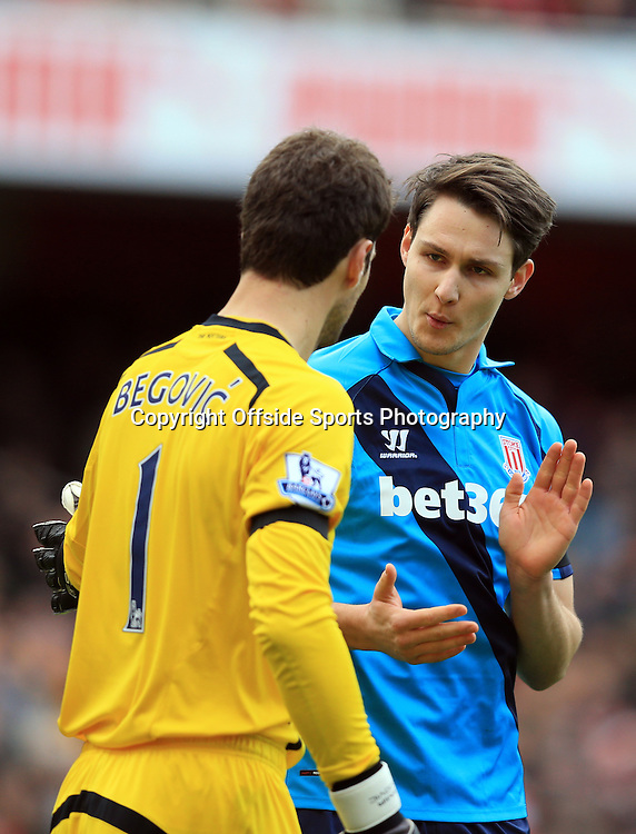 11 January 2015 - Barclays Premier League - Arsenal v Stoke City - Phillipp Wollscheid of Stoke City with goalkeeper, Asmir Begovic of Stoke City - Photo: Marc Atkins / Offside.