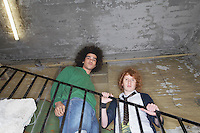 Two young men in old dilapidated building