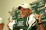 Brett Favre shows off his Jets jersey during a press conference with New York Jets owner Woody Johnson and general manager Mike Tannenbaum  August 7, 2008 at Cleveland Browns Stadium