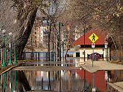 29 MARCH 2019 - ST. PAUL, MN: Harriet Island Road S in St. Paul is covered by floodwaters from the Mississippi River. The Mississippi River through the Twin Cities has already hit flood stage. Several roads and parks in St Paul are already closed in anticipation of higher flood levels. Weather forecasters and hydrologists have backed off a little on earlier predictions of severe flooding because the snow melt has been slower than expected.     PHOTO BY JACK KURTZ