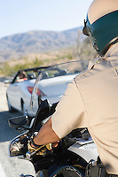 Police officer stopping car