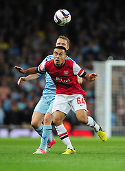 Arsenal's Nico Yennaris battles for the ball with Coventry City's Joe Murphy - Photo mandatory by-line: Joe Meredith/JMP  - Tel: Mobile:07966 386802 26/09/2012 - Arsenal v Coventry City  - SPORT - FOOTBALL - Capital One League Cup -  London  - Emirates Stadium