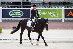 Timothy Tsang, (HKG), Shadow - Individual Test Grade II Para Dressage - Alltech FEI World Equestrian Games™ 2014 - Normandy, France.<br /> © Hippo Foto Team - Jon Stroud <br /> 25/06/14