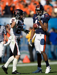 Texas Tech wide receiver Danny Amendola (20) celebrates after a pass reception in front of Virginia cornerback Mike Parker (43).  The Texas Tech Red Raiders defeated the Virginia Cavaliers 31-28 in the 2008 Konica Menolta Gator Bowl held at the Jacksonville Municipal Stadium in Jacksonville, FL on January 1, 2008.