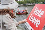 Leave supporters watch from Westminster Bridge - Nigel Farage, the leader of Ukip, joins a flotilla of fishing trawlers up the Thames to Parliament to call for the UK's withdrawal from the EU, in a protest timed to coincide with prime minister's questions.