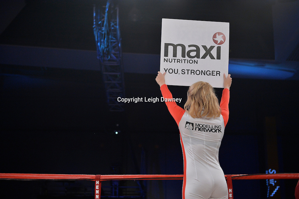 Ring card girl shows round card during the Nick Blackwell v Nathan King  middleweight boxing contest at Glow, Bluewater, Kent on the 8th November 2014. Promoter: Hennessy Sports. © Leigh Dawney Photography 2014.