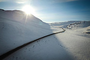 The Dempster Highway stretches winds through the Richardson Mountains near the NWT/Yukon border.