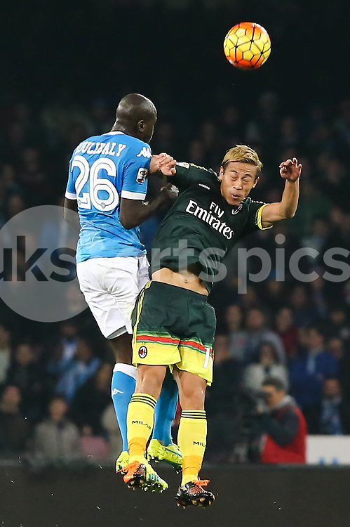 Kalidou Koulibaly of Napoli and Keisuke Honda of AC Milan challenge for the ball during the Serie A TIM match between Napoli and AC Milan at Stadio San Paolo, Naples, Italy on 22 February 2016. Photo by Alfredo Panico.