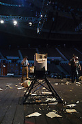 Pieces of logs litter the stage after warm-ups at the Stihl Timbersports Championships at The Norfolk Scope in Norfolk, Virginia while preparing for the event on June 19, 2014.