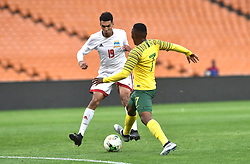 South Africa: Johannesburg: Bafana Bafana player Lebohang Maboe battle for the ball with Seychelles player Karl Hopprich during the Africa Cup Of Nations qualifiers at FNB stadium, Gauteng.<br />