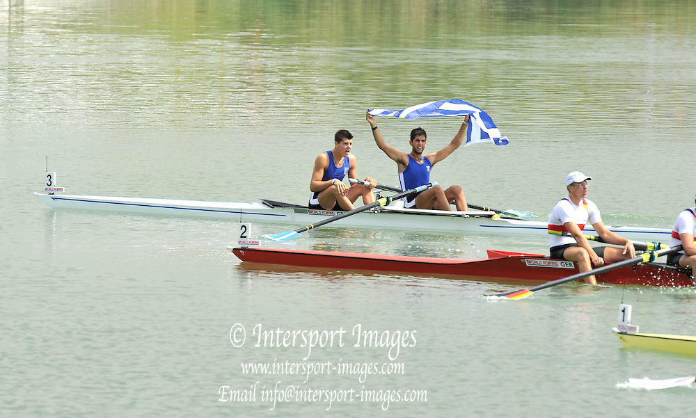 Racice, CZECH REPUBLIC.  Gold medalist GRE JM2- raise the flag.  2010 FISA Junior World Rowing Championships. Sunday,  08/08/2010.  [Mandatory Credit Peter Spurrier/ Intersport Images]