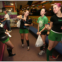 Left to Right, Jenn Angele, Celeste Lajoine, Hope Renee, and Megan Hucks, members of the Greenville Rollergirls joke around after practice at Galaxy Sports in Kinston, N.C.
