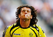 Dortmund's Nelson Valdez spits during the match between HSV and Borussia Dortmund in Hamburg.