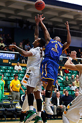 Nov 16, 2011; San Francisco CA, USA;  San Jose State Spartans guard Calvin Douglas (5) and San Francisco Dons guard Rashad Green (13) reach for a rebound during the second half at War Memorial Gym.  San Francisco defeated San Jose State 83-81 in overtime. Mandatory Credit: Jason O. Watson-US PRESSWIRE