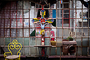A garden still life with a colorful painted cross located on a village close to the city of Svitavy in Czech Republic.