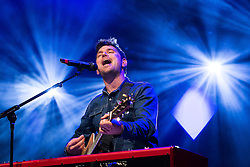 © Licensed to London News Pictures . 07/11/2015 . Manchester , UK . Lead singer ROY STRIDE playing with Scouting for Girls ahead of the Christmas Lights switch on , in Albert Square in front of Manchester Town Hall . Photo credit : Joel Goodman/LNP