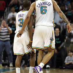 New Orleans Hornets center Tyson Chandler #6 (right) congratulates Chris Paul #3 (left) as both exited near the end of their game against the Golden State Warriors in the fourth quarter of their NBA game on April 6, 2008 at the New Orleans Arena in New Orleans, Louisiana. The New Orleans Hornets defeated the Golden State Warriors 108-96.