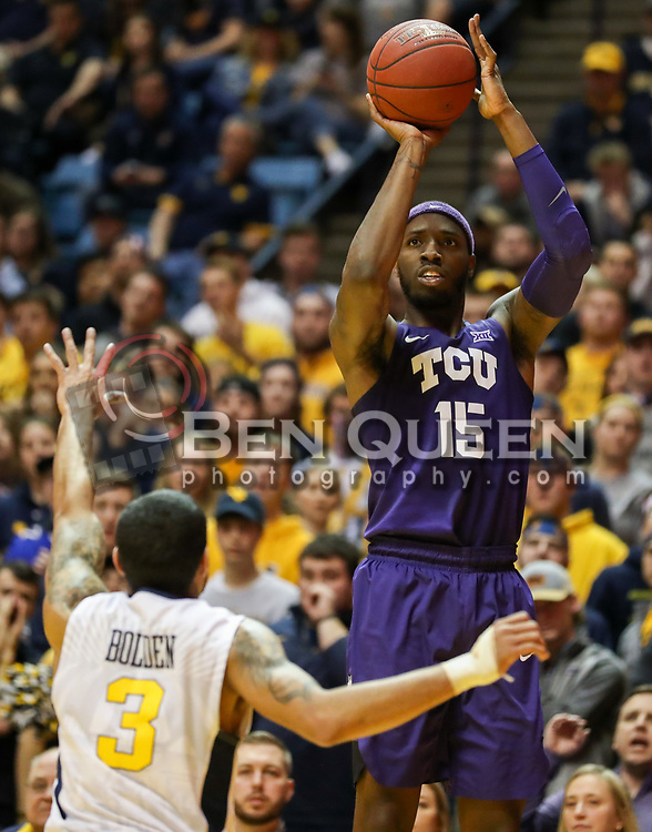 Feb 12, 2018; Morgantown, WV, USA; TCU Horned Frogs forward JD Miller (15) shoots over West Virginia Mountaineers guard James Bolden (3) during the first half at WVU Coliseum. Mandatory Credit: Ben Queen-USA TODAY Sports