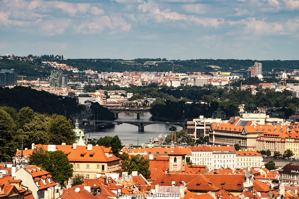 view over Prague skyline from the Strahov Monestary high on the hills above Prague, with the Bridges connecting Prague old and new town as center in the Photo.