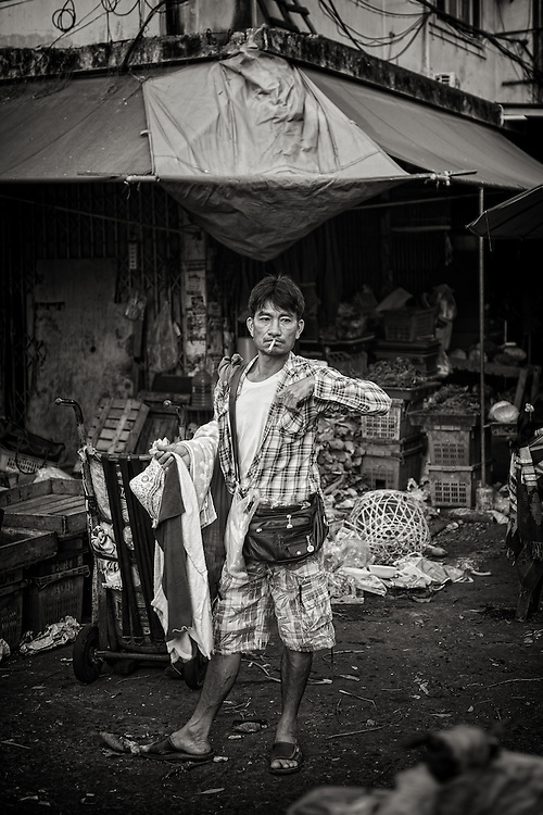 A towel vendor in Klong Toei Market, Bangkok, Thailand. PHOTO BY LEE CRAKER