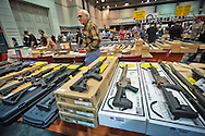 December 16th,  Larry, The owner of Larry Guns behind a display of AR 15's and AK 47s,  says he is selling his high ticket value guns better then ever at the gun show in the Pontchartrain Center in Kenner, Louisiana held by Great Southern Gun and Knife Shows L.L. C. . Gun sales have increased since the school shooting massacre in Sandy Hook Connecticut, especially AR 15s, one of the types of guns used by shooter Adam Lanza,  as gun owners fear new legislature will soon regulate sales of such guns.