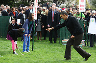 President Obama directs daughters Sasha and Malia at the White House Easter Egg Roll on the South Lawn of the White House on April 13, 2009.  Photograph by Dennis Brack