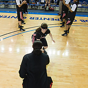 Northeastern Guard Jamie Conroy (15) (Middle) high fives her teammate during player introductions prior the start of a Colonial Athletic Association conference Basketball Game against Delaware Sunday, Feb. 26, 2012, at the Bob Carpenter Center in Newark, Del.