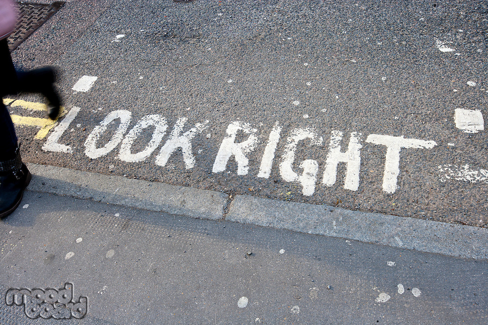 Close-Up of road marking saying Look Right in London, UK