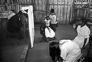 Índios guarani Kaiowás, Mato Grosso do Sul - outubro de 2000. Culto Pentecostal da igreja Visão Missionária rezado pelo índio- pastor-cooperador Walberto Lopes, filho do índio pastor Simão Lopes. Reserva de Amambai no município de Amambaí, MS..Indians Guarani Kaiowás, Mato Grosso do Sul - October of 2000. Cult Pentecostal of the church Missionary Vision prayed by the Indian-shepherd-cooperator Walberto Lopes, son of the Indian shepherd Simão Lopes. Reservation of Amambai in the municipal district of Amambaí, MS..Índios guarani Kaiowás, Mato Grosso do Sul - outubro de 2000. Culto Pentecostal da igreja Visão Missionária rezado pelo índio- pastor-cooperador Walberto Lopes, filho do índio pastor Simão Lopes. Reserva de Amambai no município de Amambaí, MS..Indians Guarani Kaiowás, Mato Grosso do Sul - October of 2000. Cult Pentecostal of the church Missionary Vision prayed by the Indian-shepherd-cooperator Walberto Lopes, son of the Indian shepherd Simão Lopes. Reservation of Amambai in the municipal district of Amambaí, MS.
