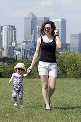 © Licensed to London News Pictures. 19/05/2014<br /> Mother and Daughter enjoying a walk.<br /> Sunny weather today 19/05/2014<br /> People relaxing and enjoying the hot and sunny day in Greenwich Park,Greenwich,London.<br /> Photo credit :Grant Falvey/LNP