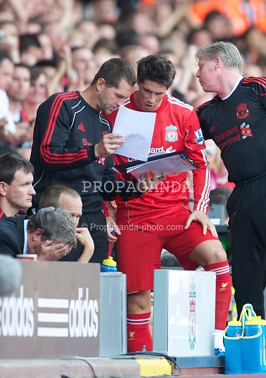 LIVERPOOL, ENGLAND - Sunday, August 15, 2010: Liverpool's Fernando Torres prepares to come on as a substitute against Arsenal during the Premiership match at Anfield. (Pic by: David Rawcliffe/Propaganda)