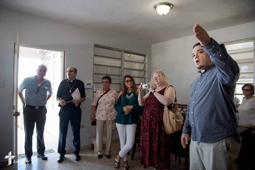 William Torres tours with Foro members the Casa de Amparo y Respuesta a Desastre (CARD), or House of Refuge and Mercy Response mercy center, a part of the Iglesia Luterana Principe de Paz (Prince of Peace Lutheran Church), Mayagüez, Puerto Rico, on Sunday, April 15, 2018. LCMS Communications/Erik M. Lunsford