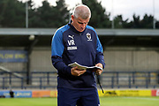 AFC Wimbledon coach Vaughan Ryan looking at notebook during the EFL Trophy (Leasing.com) match between AFC Wimbledon and U23 Brighton and Hove Albion at the Cherry Red Records Stadium, Kingston, England on 3 September 2019.