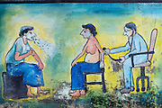 See the doctor. Painted wall - public building. Puttalam.
