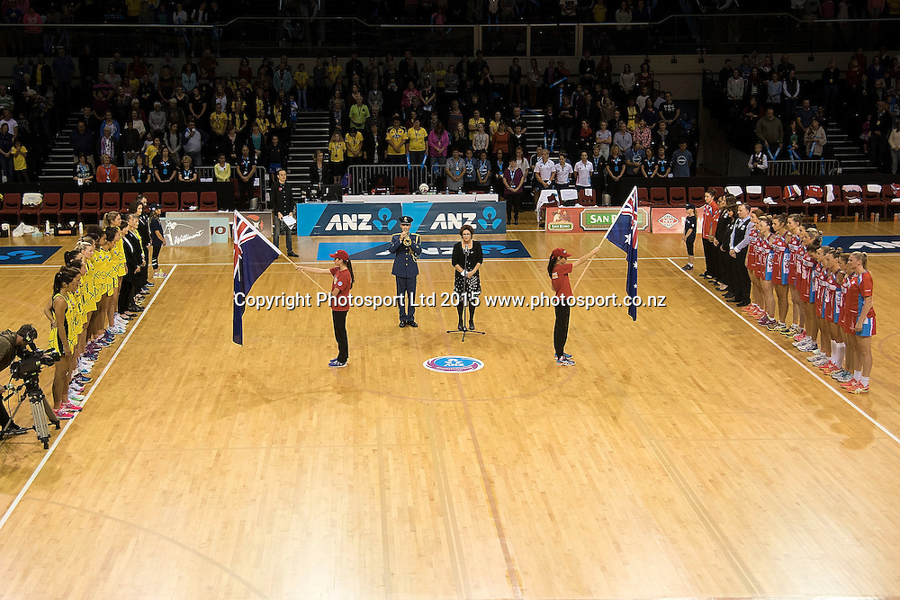 The Pulse (L) and Swifts (R stand as the last post is played as netball remembers ANZAC Day during the ANZ Championship - Pulse v Swifts netball match at the TSB Arena in Wellington on Saturday the 25th of April 2015. Photo by Marty Melville / www.Photosport.co.nz