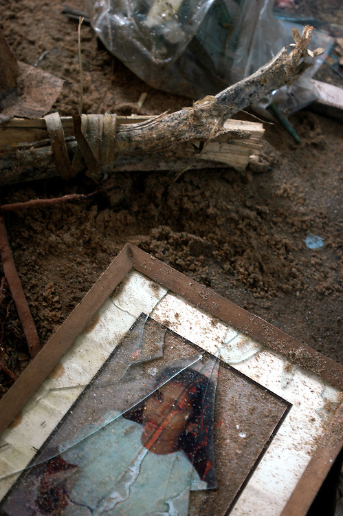 Vestiges of a shattered life lie on the floor of a home ruined by the December 26, 2004 tsunami that struck south east Asia...Batticaloa, Sri Lanka. 11/01/2005...Photo © J.B. Russell