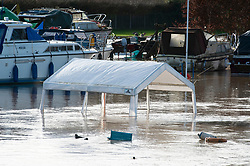 ©Licensed to London News Pictures 21/12/2019. <br /> Wateringbury ,UK. This marquee is nearly fully underwater on the river bank.  The River Medway at Bow Hill Wateringbury, Kent has bursts its banks causing severe flooding to the Marina area.   Photo credit: Grant Falvey/LNP
