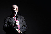 Man in full suit singing into microphone