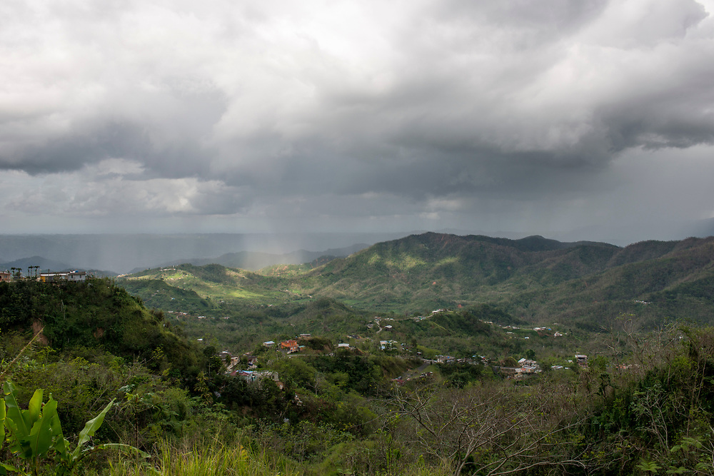 Adjuntas, PR, November 10, 2017--Rain falls on the mountains in Adjuntas, PR. Communities throughout Puerto Rico continue to struggle with the aftermath of Hurricane Maria. Residents are waiting to hear from FEMA, whether or not they will receive financial help to replace their blue tarps with new roofs. Photo by Lori Waselchuk/braf.org