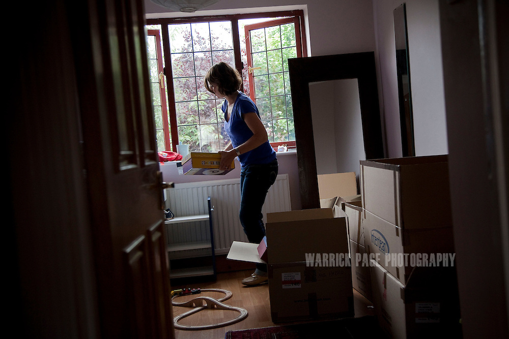 Eva Vildosola unpacks the remainder of her family's belongings at their new home, on September 1, 2012, in Buckden, England. The Spanish family immigrated to England due to the ongoing economic crisis that has impacted heavily on Spain. (Photo by Warrick Page)