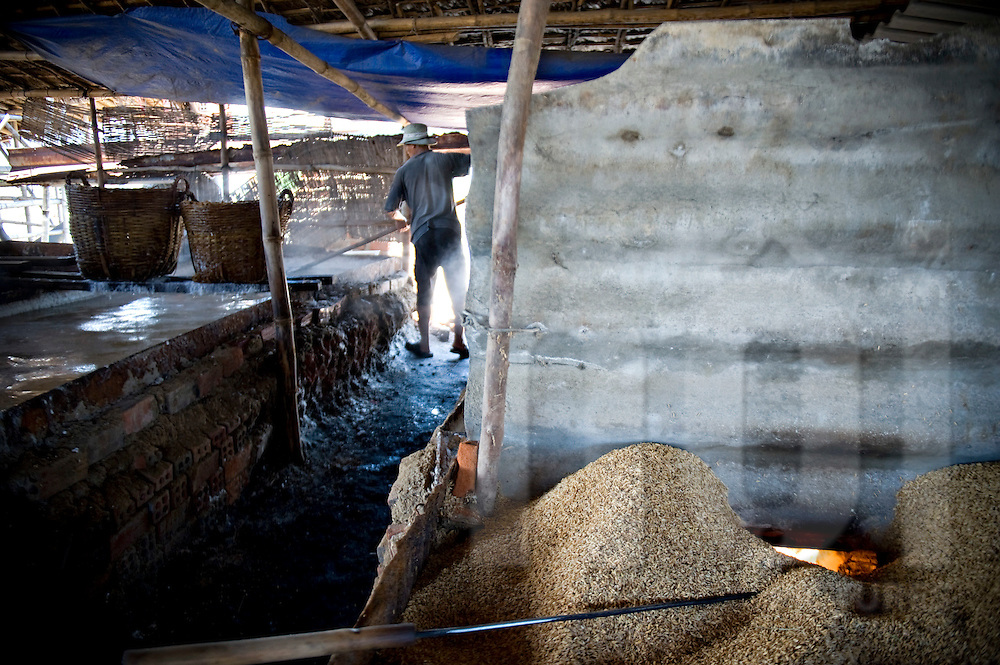 Salt factory in Khanh Hoa area, Vietnam, Southeast Asia. Salt is boiled in big vats, supplied by seeds burning.
