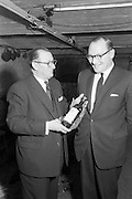18/04/1963<br /> 04/18/1963<br /> 18 April 1963<br /> Friends of the Wine Club group inaugurated at the House of Morgan, 36 Dawson Street, Dublin.  Picture shows John Morgan (right), Chairman of the House of Morgan, and fellow Director Felix Hughes discussing the wines available to members of the club.