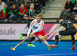 England's Ashley Jackson cuts inside Martin Zwicker of Germany. England v Germany - Semi-Final Unibet EuroHockey Championships, Lee Valley Hockey & Tennis Centre, London, UK on 27 August 2015. Photo: Simon Parker