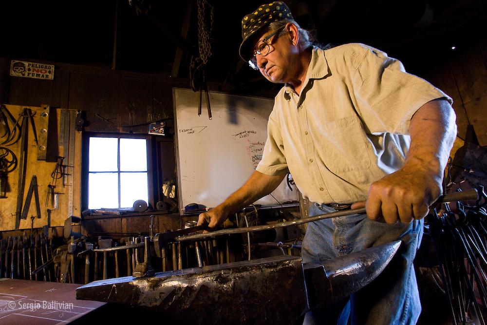 Frank Turley makes custom iron pieces in his blacksmith shop in Santa Fe, New Mexico.