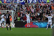 Swansea city's Pablo Hernandez (c) celebrates after he scores the opening goal. Barclays Premier league, Swansea city v Wigan Athletic at the Liberty Stadium in Swansea, South Wales on Saturday 20th October 2012. pic by Andrew Orchard, Andrew Orchard sports photography,