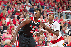 North Carolina State forward Abdul-Malik Abu, left, and Louisville guard Terry Rozier. <br /> <br /> The University of Louisville hosted the North Carolina State, Saturday, Feb. 14, 2015 at the Yum Center in Louisville. <br /> <br /> Photo by Jonathan Palmer