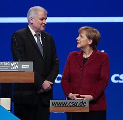 """20.11.2015, Messe Muenchen, Muenchen, GER, CSU Parteitag 2015, Festakt """"70 Jahre CSU"""", im Bild Bundeskanzlerin Dr. Angela Merkel mit Ministerpraesident Horst Seehofer am Rednerpult // during ceremony """"70 years CSU"""" of CSU party convention in 2015 at the Messe Muenchen in Muenchen, Germany on 2015/11/20. EXPA Pictures © 2015, PhotoCredit: EXPA/ Eibner-Pressefoto/ Krieger<br /> <br /> *****ATTENTION - OUT of GER*****"""