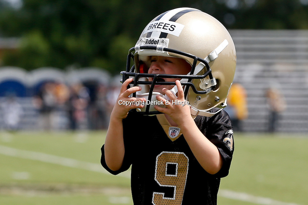 Aug 3, 2013; Metairie, LA, USA; New Orleans Saints quarterback Drew Brees (not pictured) son Bowen Brees wears his dad's helmet following a scrimmage at the team training facility. Mandatory Credit: Derick E. Hingle-USA TODAY Sports