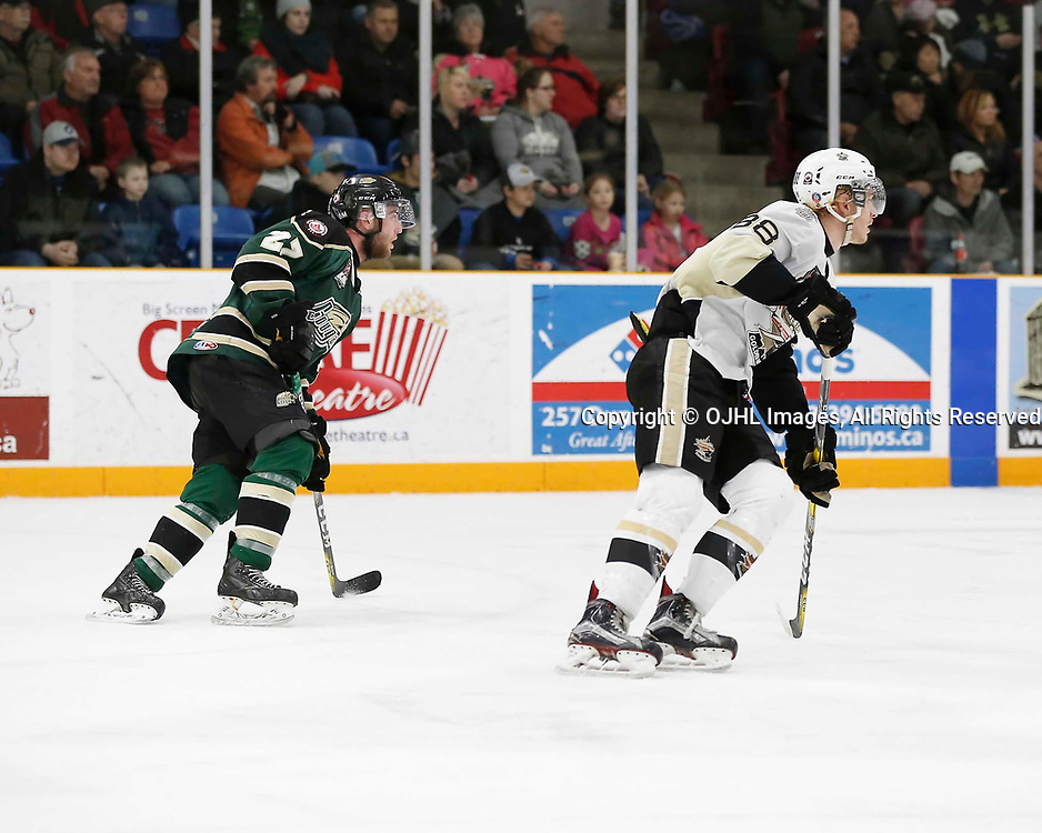 TRENTON, ON - MAR 31,  2017: Ontario Junior Hockey League, North East Conference Championship game between Trenton Golden Hawks and the Cobourg Cougars., Brennan Roy #27 of the Cobourg Cougars and Michael Silveri #88 of the Trenton Golden Hawks skates up ice<br /> (Photo by Amy Deroche / OJHL Images)