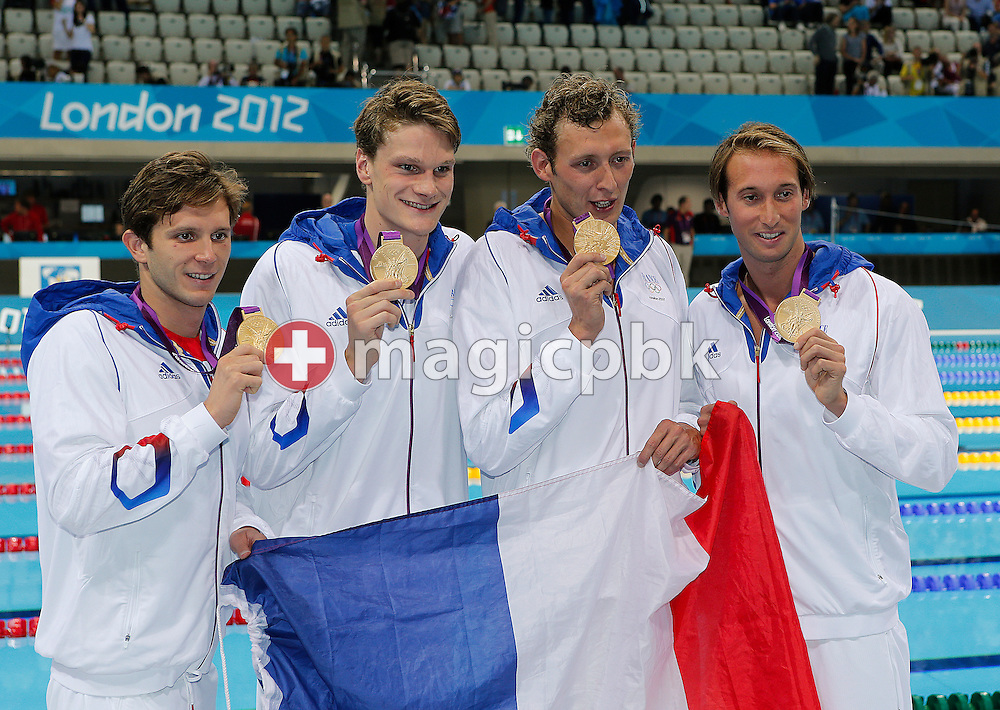 (L-R) Clement Lefert, Yannick Agnel, Amaury Leveaux and Fabien Gilot of France pose with a French flag and their Gold medals after winning the men's 4x100m Freestyle Relay Final during the Swimming competition held at the Aquatics Center during the London 2012 Olympic Games in London, Great Britain, Sunday, July 29, 2012. (Photo by Patrick B. Kraemer / MAGICPBK)